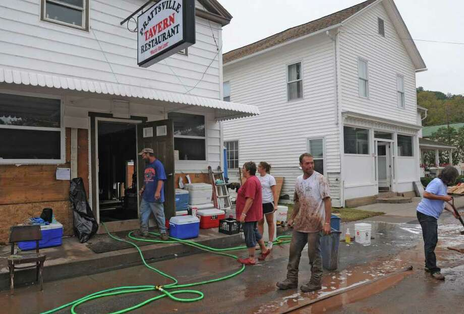People clean up the Prattsville Tavern Restaurant on Main St. in Prattsville, N.Y. on Sept. 8, 2011. The Schoharie Creek flooded the town after tropical storm Irene. Photo: Lori Van Buren, Lori Van Buren / Times Union