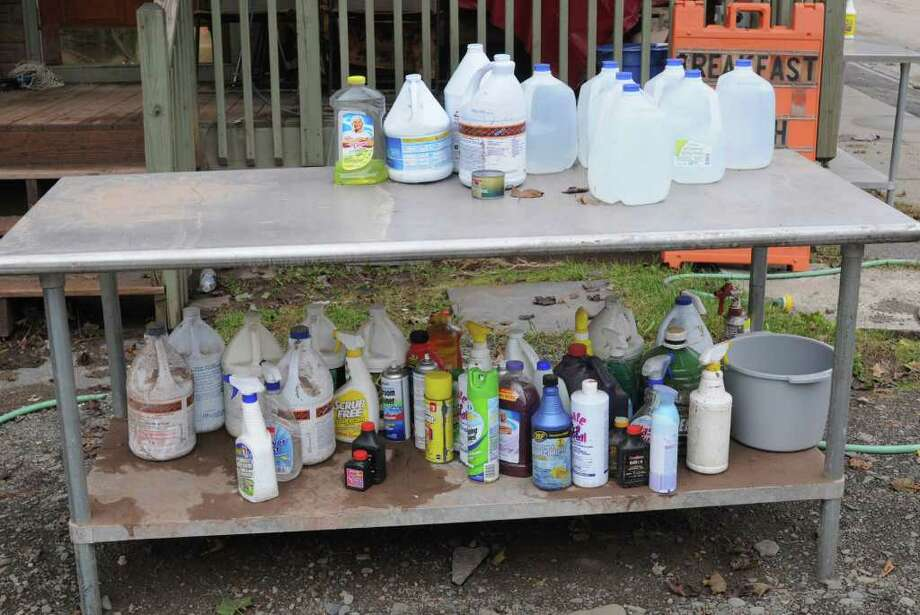Bottles of water and cleaning supplies on a table outside a building on Main St. in Prattsville, N.Y. on Sept. 8, 2011. The Schoharie Creek flooded the town after tropical storm Irene. Photo: Lori Van Buren, Lori Van Buren / Times Union