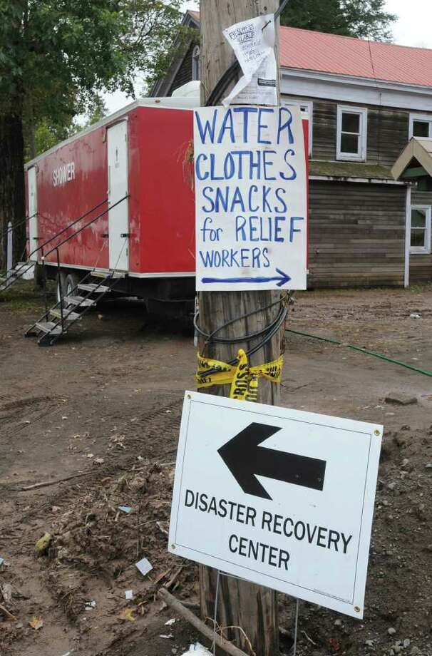 Signs on a pole on Main St. in Prattsville, N.Y. on Sept. 8, 2011. The Schoharie Creek flooded the town after tropical storm Irene. Photo: Lori Van Buren, Lori Van Buren / Times Union