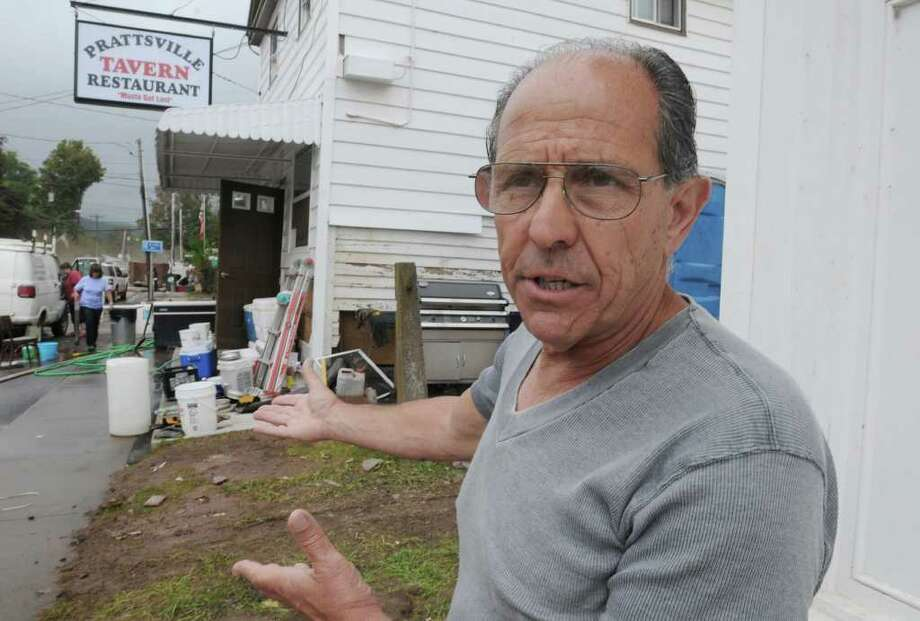 Public Information Officer Al Creazzo talks about the clean in Prattsville, N.Y. on Sept. 8, 2011. The Schoharie Creek flooded the town after tropical storm Irene. Photo: Lori Van Buren, Lori Van Buren / Times Union