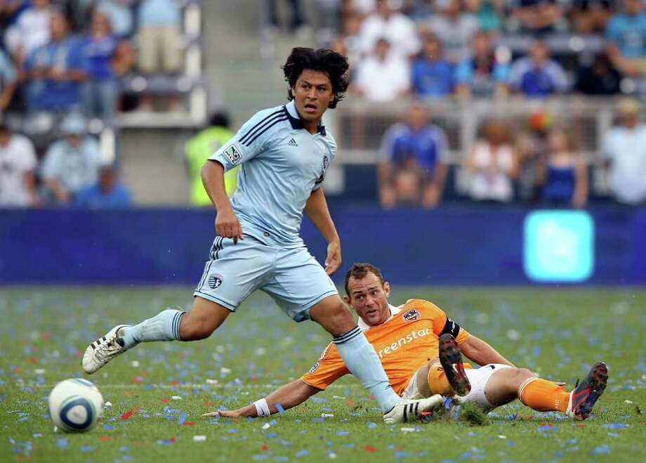 KANSAS CITY, KS - SEPTEMBER 10:  Brad Davis #11 of the Houston Dynamo battles Roger Espinoza #15 of Sporting Kansas City for the ball during the MLS game on September 10, 2011 at LiveStrong Sporting Park in Kansas City, Kansas. Photo: Jamie Squire, Getty / 2011 Getty Images