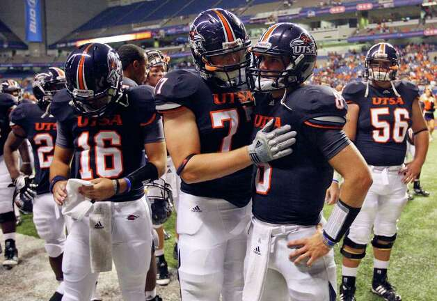 UTSA's James Bakke (center left) talks with teammate UTSA's Eric Soza after the game with McMurry Saturday Sept. 10, 2011 at the Alamodome.  McMurry won 24-21. Photo: EDWARD A. ORNELAS, Express-News / SAN ANTONIO EXPRESS-NEWS (NFS)