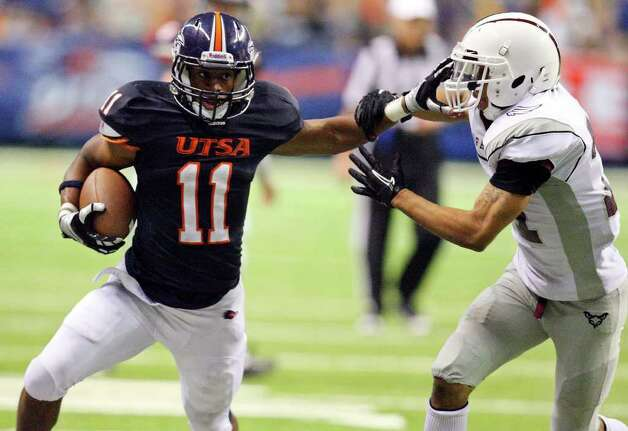 UTSA's David Glasco II looks for room around McMurry's Gene Hudson during second half action Saturday Sept. 10, 2011 at the Alamodome.  McMurry won 24-21. Photo: EDWARD A. ORNELAS, Express-News / SAN ANTONIO EXPRESS-NEWS (NFS)