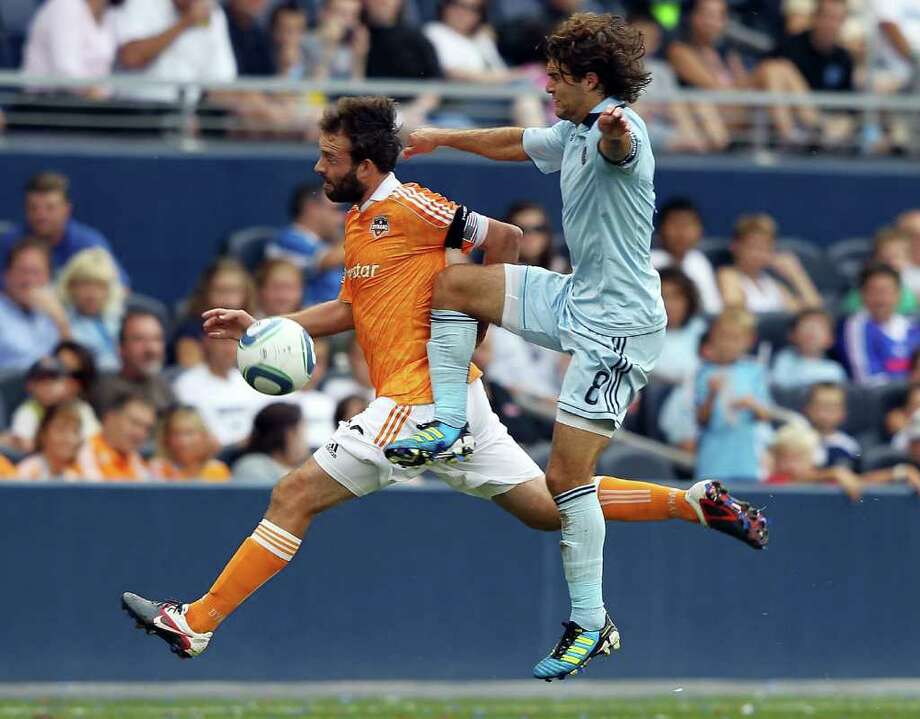 KANSAS CITY, KS - SEPTEMBER 10:  Adam Moffat #16 of the Houston Dynamo competes with Graham Zusi #8 of Sporting Kansas City for the ball during the MLS game on September 10, 2011 at LiveStrong Sporting Park in Kansas City, Kansas. Photo: Jamie Squire, Getty / 2011 Getty Images