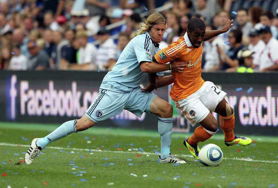 KANSAS CITY, KS - SEPTEMBER 10:  Corey Ashe #26 of the Houston Dynamo battles Chance Myers #7 of Sporting Kansas City for the ball during the MLS game on September 10, 2011 at LiveStrong Sporting Park in Kansas City, Kansas. Photo: Jamie Squire, Getty / 2011 Getty Images