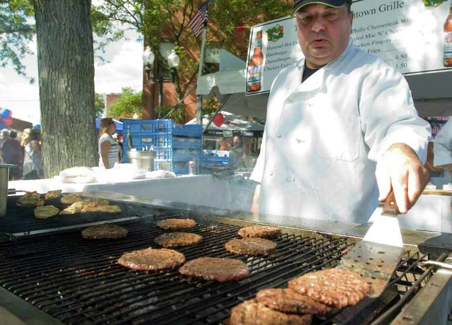 Carmen Rao mans the grill for Two Steps at the Taste of Danbury on Ives Street on Saturday, Sept. 10, 2011. Photo: Jason Rearick / The News-Times
