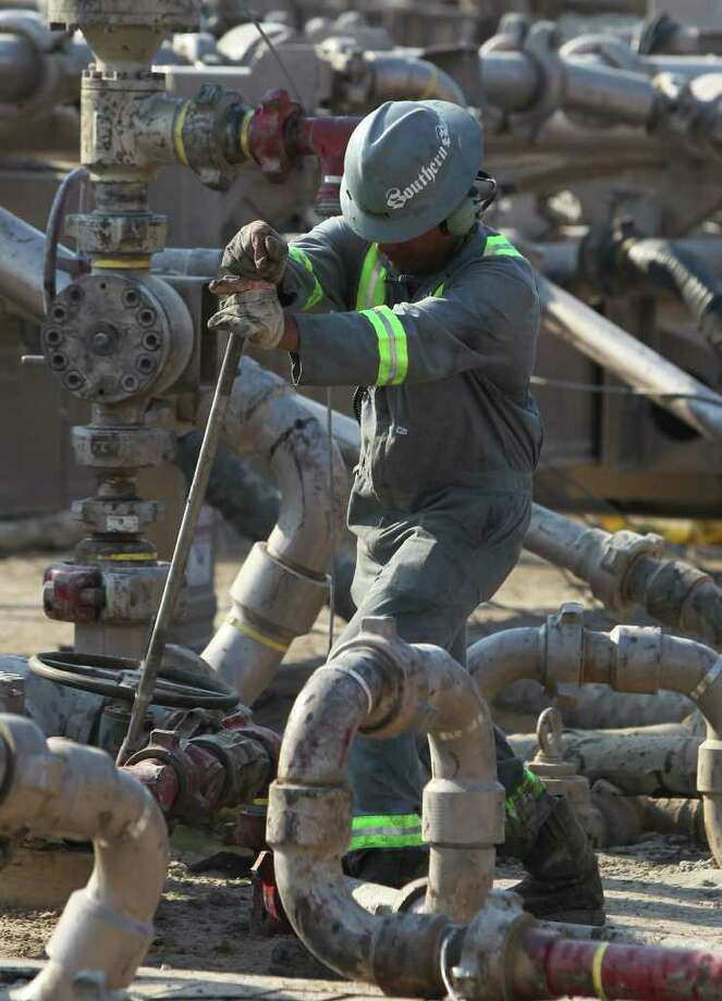An oil field employee works at the  fracturing site near Cotulla that Statoil's CEO visited recently for a close-up look. The site is part of a joint venture between Talisman Energy and the Norwegian energy giant. Photo: JOHN DAVENPORT / HEARST NEWSPAPERS