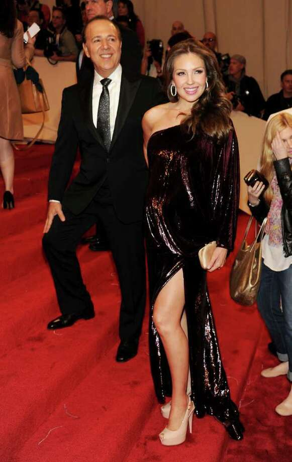 """Tommy Mottola and Thalia attend the """"Alexander McQueen: Savage Beauty"""" Costume Institute Gala at The Metropolitan Museum of Art in May 2011.  The couple, recently seen having dinner  in Banksville, N.Y., are rumored to be buying a home on John Street in Greenwich. (Photo by Larry Busacca/Getty Images) Photo: Larry Busacca, Getty Images / 2011 Getty Images"""