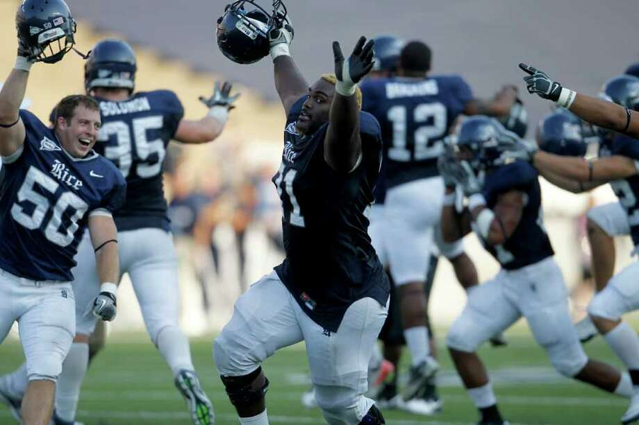 Rice players including OL Davon Allen (71) celebrate Rice's victory over Purdue during their college football game at Rice University, Saturday, Sept. 10, 2011, in Houston. Rice won the game against Purdue 24-22. Photo: Karen Warren, Houston Chronicle / © 2011 Houston Chronicle