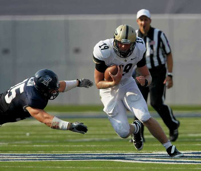 Purdue QB CalebTerBush (19) runs the ball against Rice Scott Solomon (35) during the third quarter o
