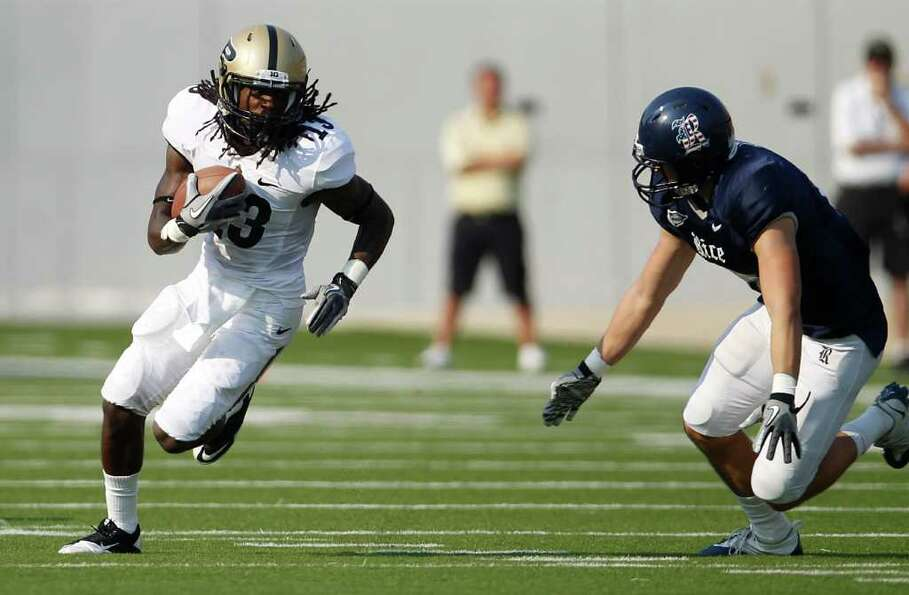 Purdue WR Antavian Edison (13) runs the ball against Rice during the third quarter of a college foot
