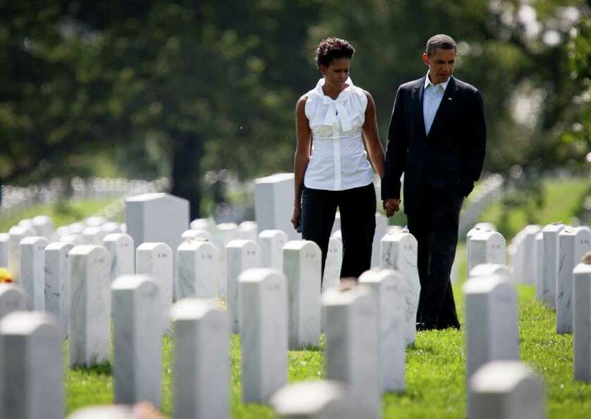 US President Barack Obama and First Lady Michelle Obama visit section 60 at Arlington National Cemet
