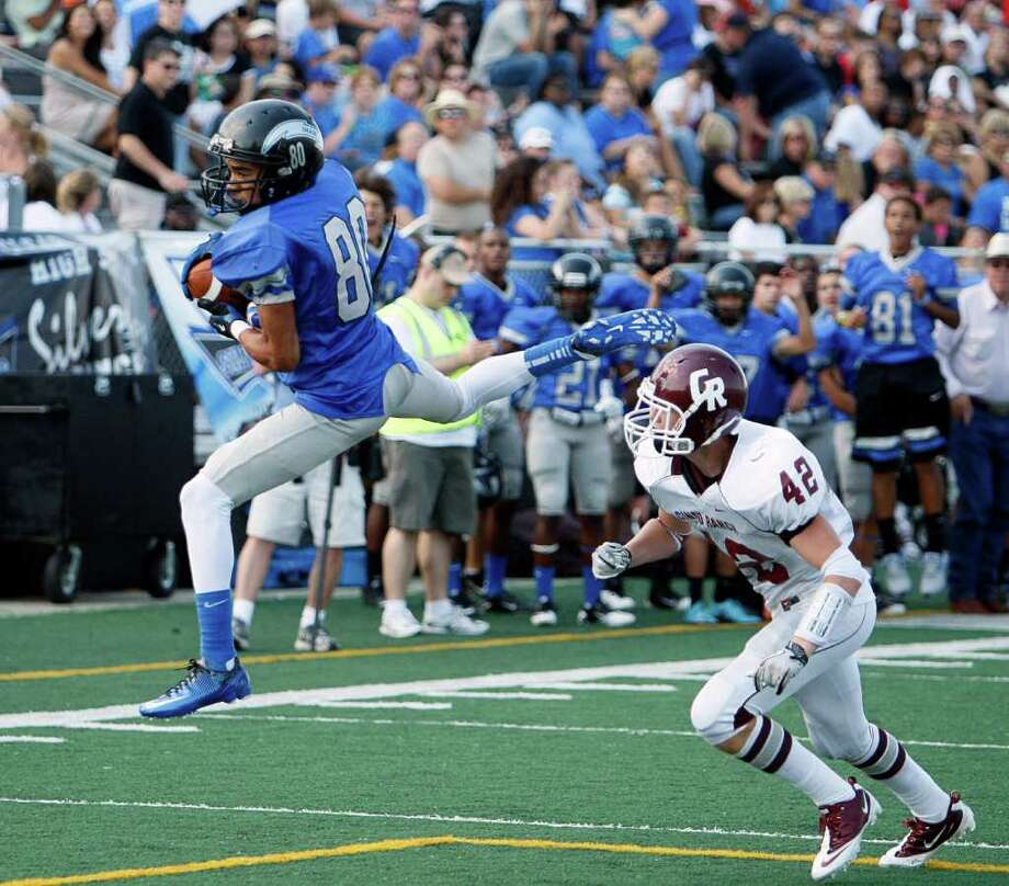 Sept. 10,2011: Clear Springs wide receiver Byron Jones (80) hauls in a pass in front off Cinco Ranch's Kevin Colpoys (42) Cinco Ranch went on to win 38-33. Photo: Bob Levey, Houston Chronicle / ©2011 Bob Levey