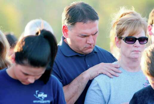 """We are praying for the community and want to lift everyone up,"" Bryan Birmingham says as he prays with his wife, Karen. Photo: Mayra Beltran, Houston Chronicle / © 2011 Houston Chronicle"