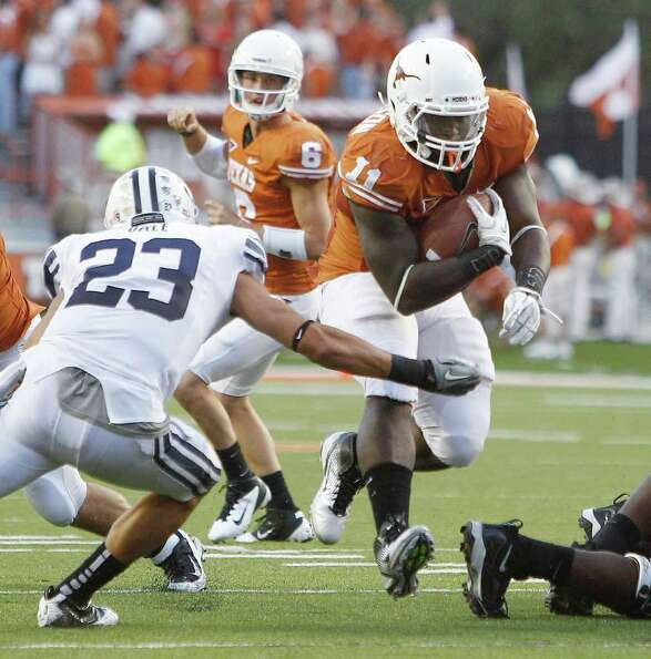 Texas' Cody Johnson (11) tries to avoid BYU defender Travis Uale (23) during the first quarter of an