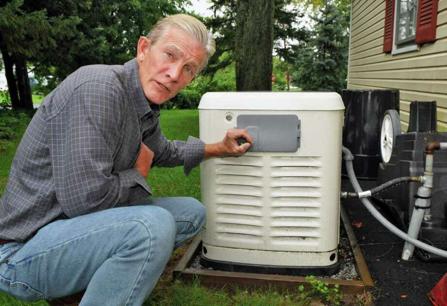Dick Yingling Jr. at the emergency power generator at his mother's Niskayuna home Thursday Sept. 9, 2011.    (John Carl D'Annibale / Times Union) Photo: John Carl D'Annibale / 00014536A