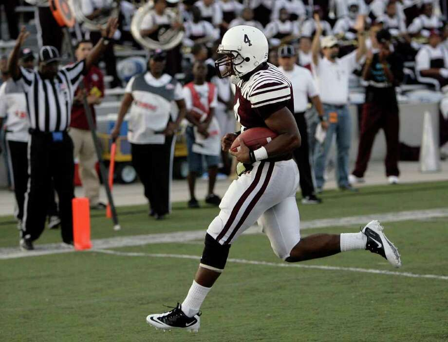 Texas Southern quarterback Dantavious Parker crosses into the end zone for a touchdown during the first quarter of a football game against   Prairie View at James M. Delmar Stadium Saturday, Sept. 10, 2011, in Houston. Photo: Cody Duty, Houston Chronicle / © 2011 Houston Chronicle