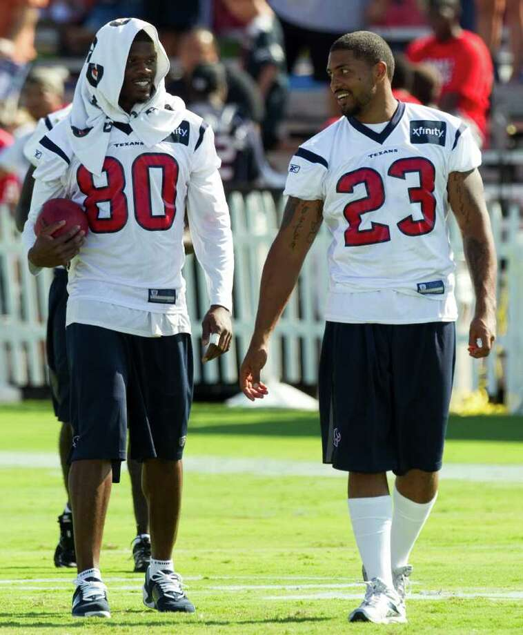 The Texans are the envy of most of the NFL when they can trot out wide receiver Andre Johnson (80) and running back Arian Foster (23). Photo: Brett Coomer / © 2010 Houston Chronicle