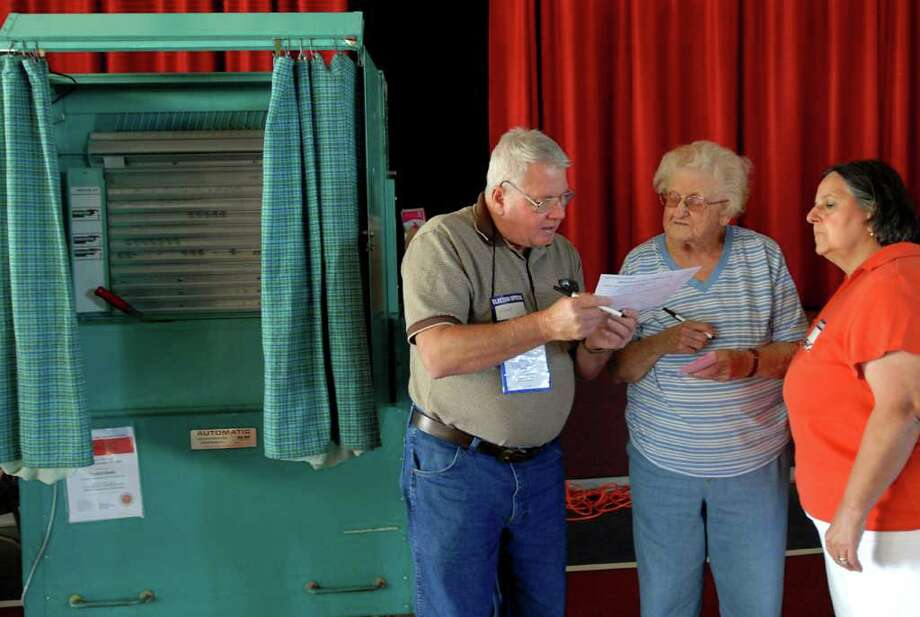 Election inspectors Frank Decatur, left, and his wife Kathy Decatur, right, assist Beatrice Knotek (cq) with an affidavit vote  on Primary Day, Tuesday, Sept. 15, 2009, at St. Gabriel's Roman Catholic Church in Rotterdam, N.Y. (Cindy Schultz / Times Union) Photo: CINDY SCHULTZ / 00005520A