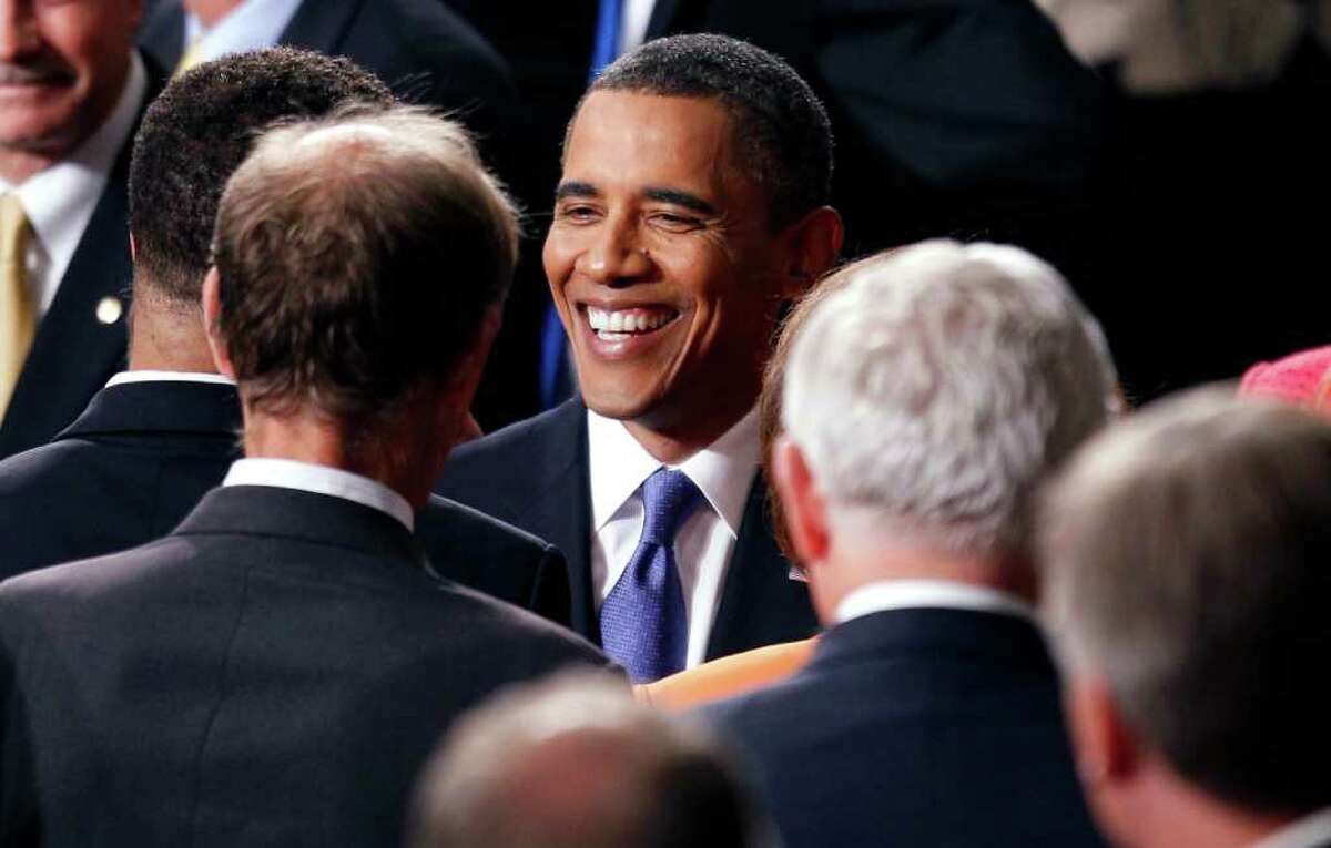 President Barack Obama greets people after speaking to a joint session of Congress at the Capitol in Washington, Thursday, Sept. 8, 2011. (AP Photo/Evan Vucci)