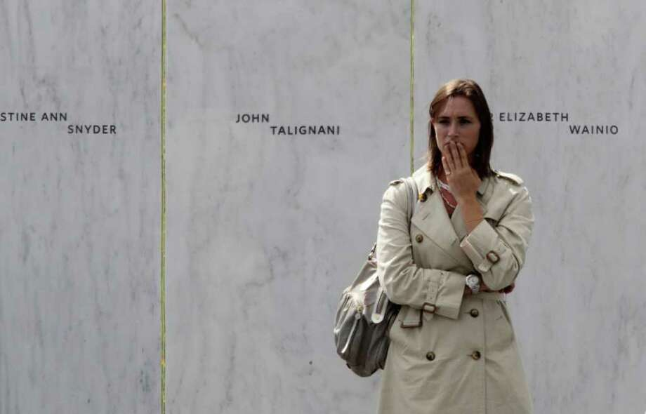 A mourner pauses as she stands at the Wall of Names after the dedication of the Flight 93 National Memorial  Sept. 10, 2011 in Shanksville, Pa. (AP Photo/Gene J. Puskar) Photo: Gene J. Puskar