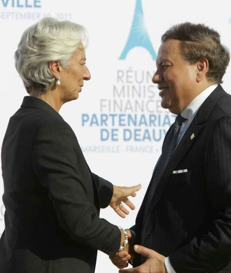 International Monetary Fund (IMF) managing director Christine Lagarde, left, talks with Tunisian Finance Minister Jelloul Ayed during the group photo at the Deauville partnership meeting in Marseille, southern France, Saturday, Sept.10, 2011.  The Deauville Partnership is a multi-billion-dollar program of aid and credit to Egypt and Tunisia that was agreed at a G8 summit in Deauville last May. Rich countries and international lenders are aiming to provide $40 billion in funding for Arab nations trying to establish true democracies. (AP Photo/Lionel Cironneau) Photo: Lionel Cironneau