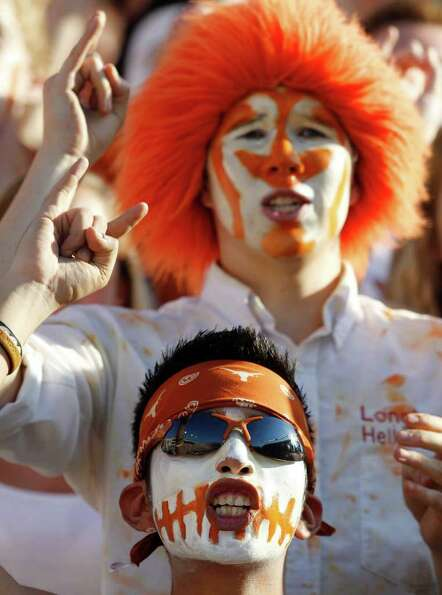 Texas fans cheer during the first quarter on an NCAA college football game against BYU, Saturday, Se