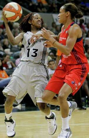 San Antonio Silver Stars' Danielle Robinson, left, looks to pass around Washington Mystics' Jasmine Thomas during the second half of a WNBA basketball game, Saturday, Sept. 10, 2011, in San Antonio. San Antonio won 82-74. Photo: Darren Abate, Express-News