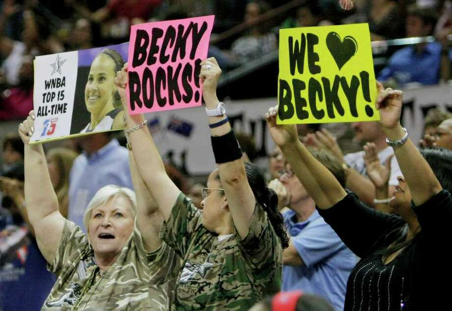 Fans hold signs in support of San Antonio Silver Stars' Becky Hammon during the second half of a WNBA basketball game against the Washington Mystics, Saturday, Sept. 10, 2011, in San Antonio. San Antonio won 82-74. Photo: Darren Abate, Express-News