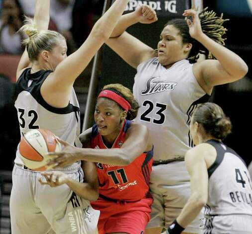 Mystics' DeMya Walker, middle-left, passes between Silver Stars' Jayne Appel, left, Danielle Adams, middle-right, and Tully Bevilaqua during the second half of a WNBA basketball game, Saturday, Sept. 10, 2011, in San Antonio. San Antonio won 82-74. Photo: Darren Abate, Express-News