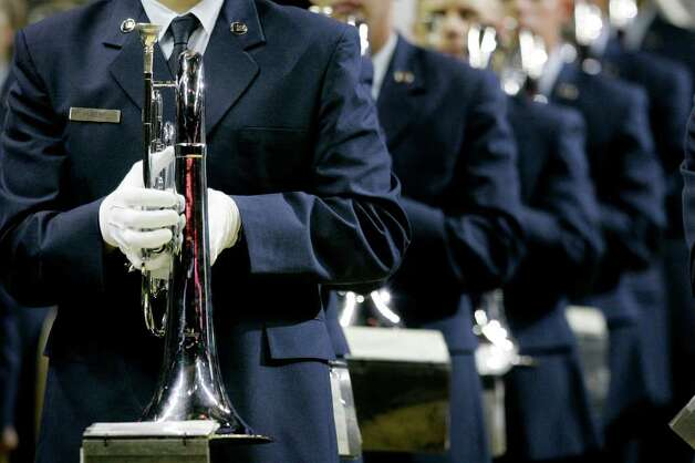 Members of the US Air Force Drum and Bugle Corps from Lackland AFB leave the court after a performance before a WNBA basketball game between the Washington Mystics and the San Antonio Silver Stars, Saturday, Sept. 10, 2011, in San Antonio. Photo: Darren Abate, Express-News