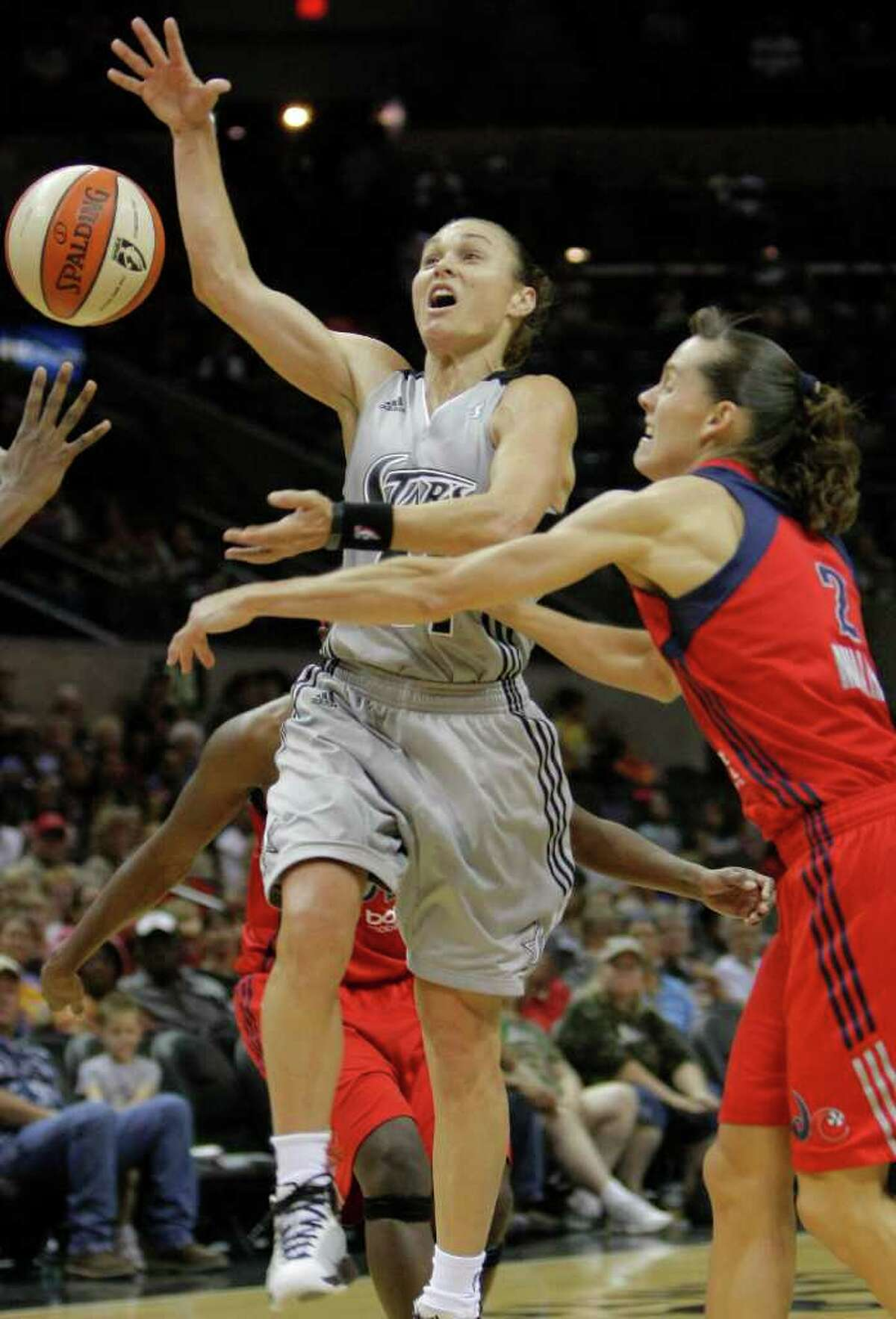 San Antonio Silver Stars' Tully Bevilaqua, left, and Washington Mystics' Kelly Miller chase a loose ball during the second half of a WNBA basketball game, Saturday, Sept. 10, 2011, in San Antonio. San Antonio won 82-74.