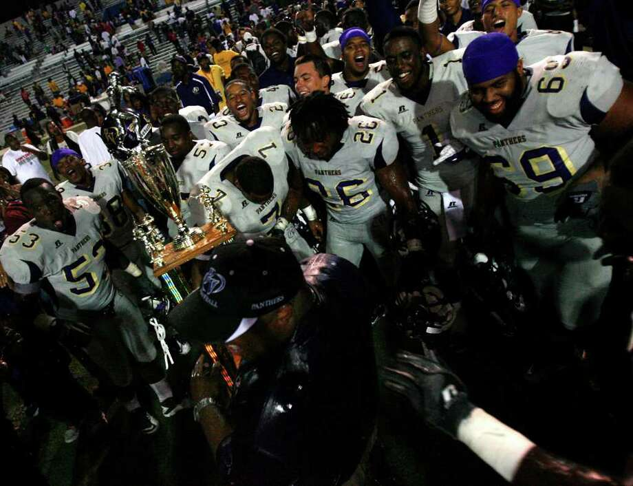 Prairie View Celebrates after a 37-34 victory over Texas Southern University at at James M. Delmar Stadium Saturday, Sept. 10, 2011, in Houston. Photo: Cody Duty, Houston Chronicle / © 2011 Houston Chronicle