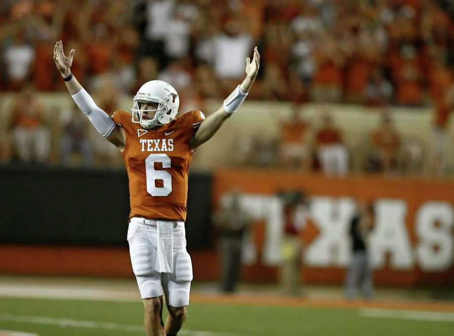AUSTIN, TX - SEPTEMBER 10:  Backup quarterback Case McCoy #6 of the Texas Longhorns signals victory over BYU Cougars as time runs out on September 10, 2011 at Darrell K. Royal-Texas Memorial Stadium in Austin, Texas. Texas defeated BYU 17-16. Photo: Erich Schlegel, Getty / 2011 Getty Images