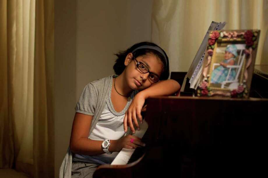 Even at her tender age, Saarah Dosani says, she has encountered discrimination. Photo: Johnny Hanson, Houston Chronicle / © 2011 Houston Chronicle