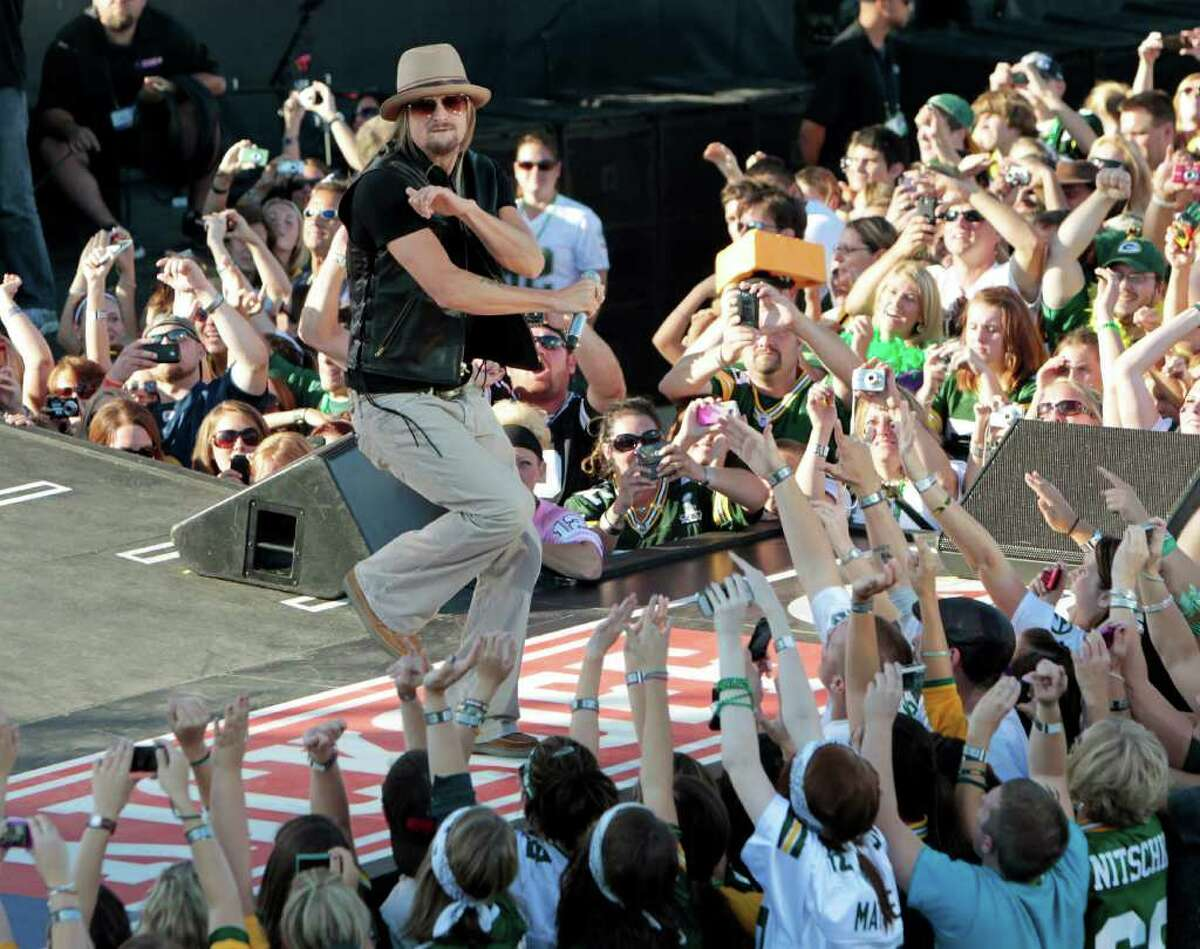 Kid Rock performs during a kickoff concert before an NFL football game between the Green Bay Packers and the New Orleans SaintsThursday, Sept. 8, 2011, in Green Bay, Wis. (AP Photo/Mike Roemer)