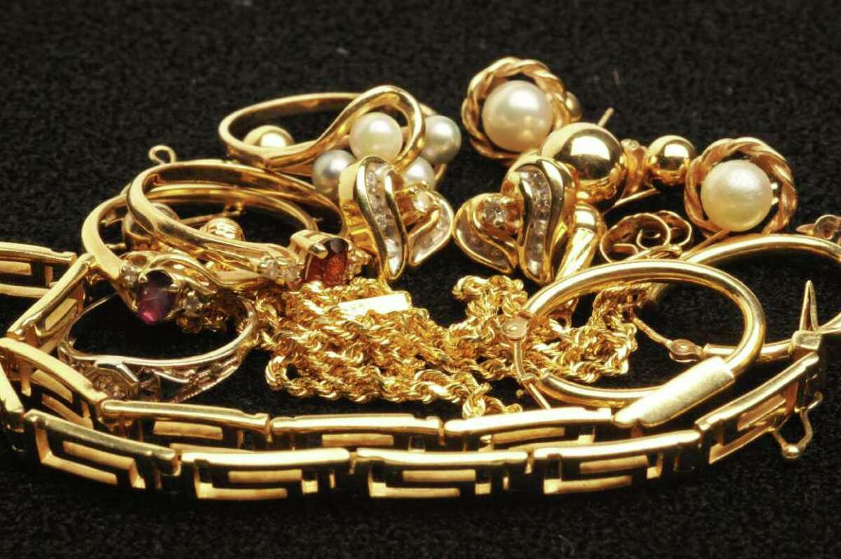 Kristi Barlette's gold jewelry in the Times Union studio in Colonie Tuesday Aug. 30, 2011. (John Carl D'Annibale / Times Union)