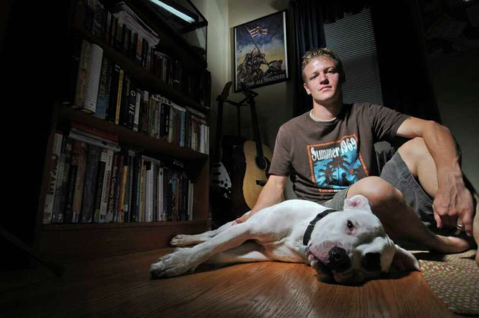 Ryan Smithson is a US Army veteran, having served in the Iraq war as part of the Army Reserves. He was photographed with his dog Ralphie on Monday Sept. 5, 2011 in Schenectady, NY. ( Philip Kamrass /Times Union)