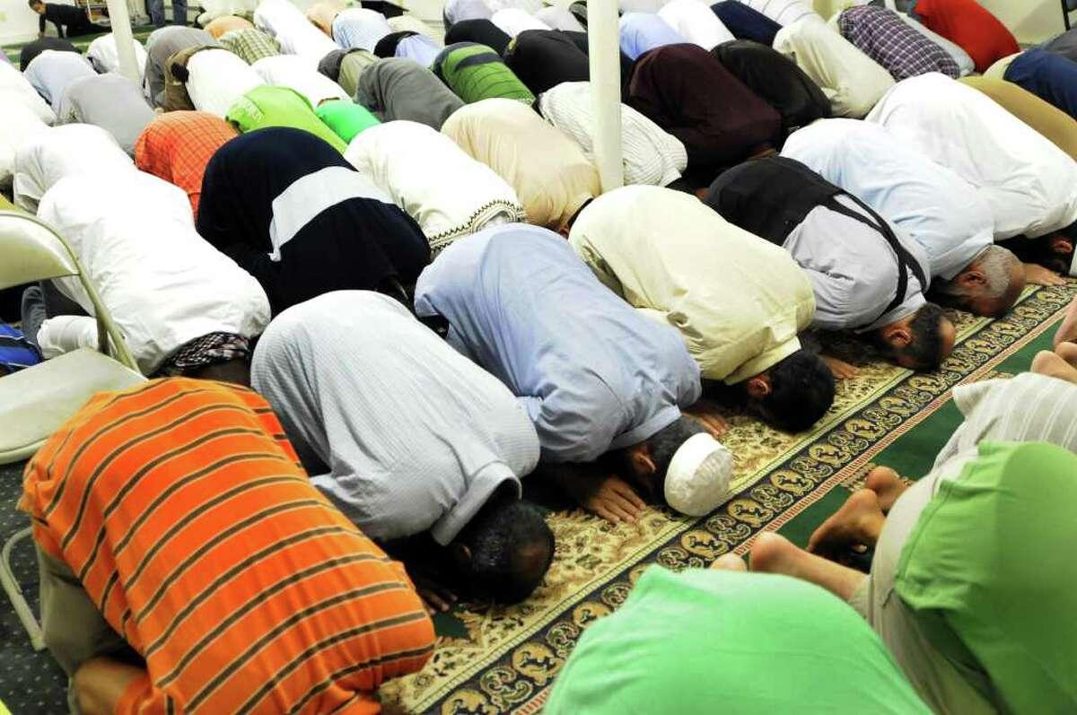 Muslim men pray during Ramadan on Thursday, Aug. 25, 2011, at Masjid Al-Salam mosque in Albany, N.Y. (Cindy Schultz / Times Union)