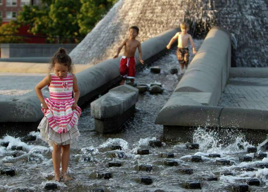 Left to right; Tuuli Walton, Isaac Lewis, and Slade Forsythe play in the fountain at Cal Anderson Park in Seattle on Saturday, Sept. 10, 2011. Photo: JOE DYER / SEATTLEPI.COM