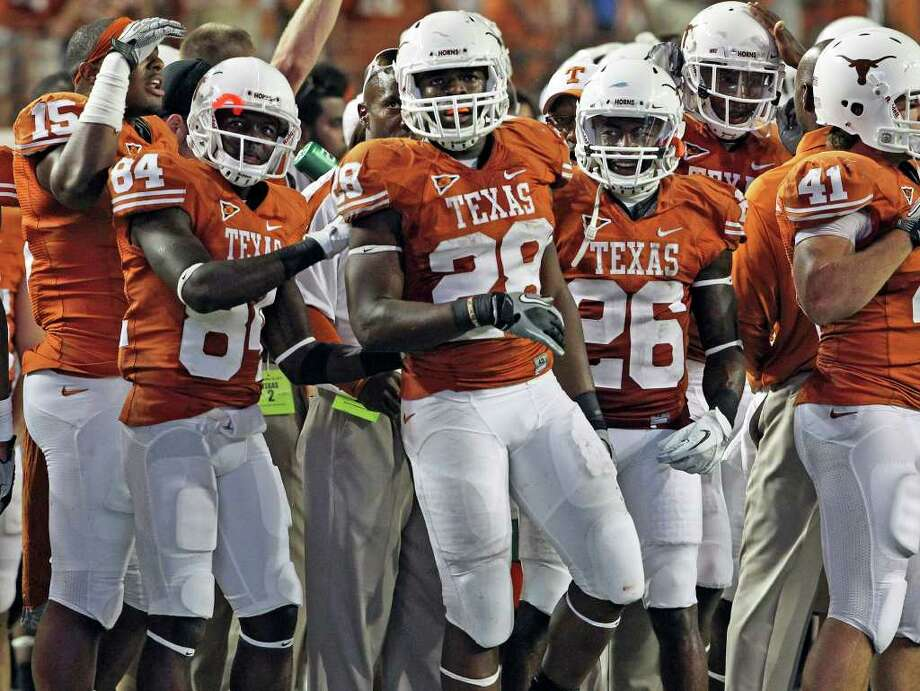 Horns running back Malcolm Brown is congratulated by Marquise Goodwin (84) and D.J. Monroe after putting the game away in the last minute with a strong run as Texas beats BYU 17-16 at Darrell K. Royal - Texas Memorial Stadium  on September 10, 2011.  Tom Reel/Staff Photo: TOM REEL, Express-News / © 2011 San Antonio Express-News