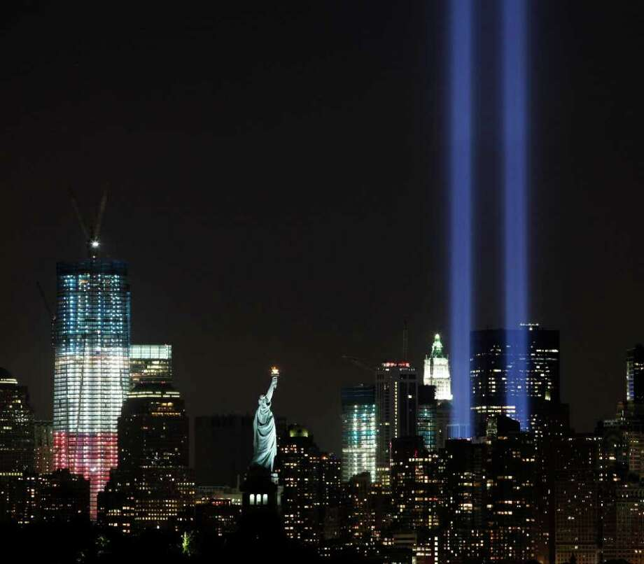 The Tribute in Light shines above lower Manhattan, the Statue of Liberty, and One World Trade Center, left, Saturday, Sept. 10, 2011 in New York. Sunday will mark the 10th anniversary of the September 11 attacks on the United States. Photo: AP