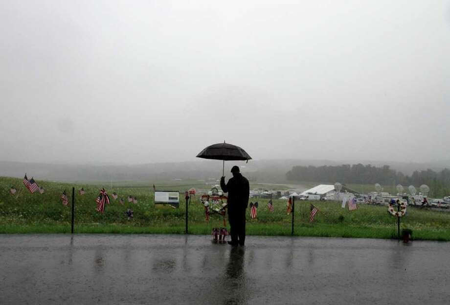 A visitor stands at the temporary memorial for United Flight 93, near where the plane crashed on 9/11, in Shanksville, Pa., Friday, Sept. 9, 2011. Photo: AP