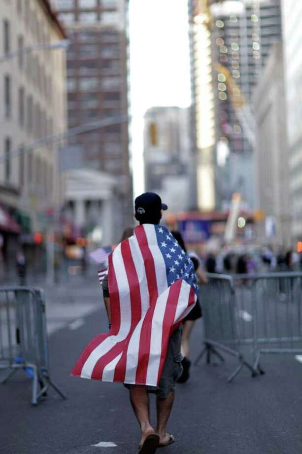 Paul Amyot, of Westchester, N.Y., walks along a street in Lower Manhattan, Sunday, Sept. 11, 2011, in New York, as he walks to  a ceremony at the National September 11 Memorial at the World Trade Center site for the 10th anniversary of the attacks. Photo: AP