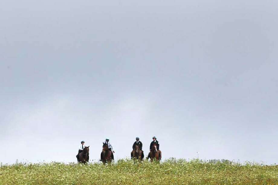 Law enforcement on horseback take position before the dedication of phase I of the permanent Flight 93 National Memorial near the crash site of Flight 93 in Shanksville, Pa. Saturday Sept. 10, 2011. Photo: AP