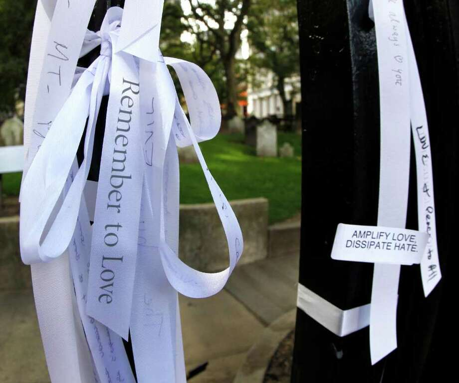 Ribbons with inspirational and personal messages are tied along the fence line of St. Paul's Chapel on Broadway, two blocks from the World Trade Center site, Saturday, Sept. 10, 2011, in New York, as officials prepare for the 10th anniversary of the 9/11 attacks. (AP Photo/The Dallas Morning News, Louis DeLuca)  MANDATORY CREDIT; MAGS OUT; TV OUT; INTERNET OUT; AP MEMBERS ONLY Photo: AP