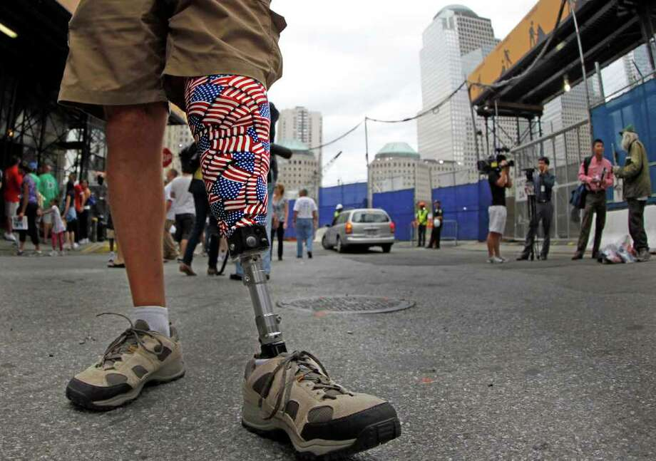 Retired Marine Dan O'Connor displays his patriotism on his prosthetic leg as he visits the World Trade Center site, Saturday, Sept. 10, 2011, in New York, as officials prepare for the 10th anniversary of the 9/11 attacks. (AP Photo/The Dallas Morning News, Louis DeLuca)  MANDATORY CREDIT; MAGS OUT; TV OUT; INTERNET OUT; AP MEMBERS ONLY Photo: AP