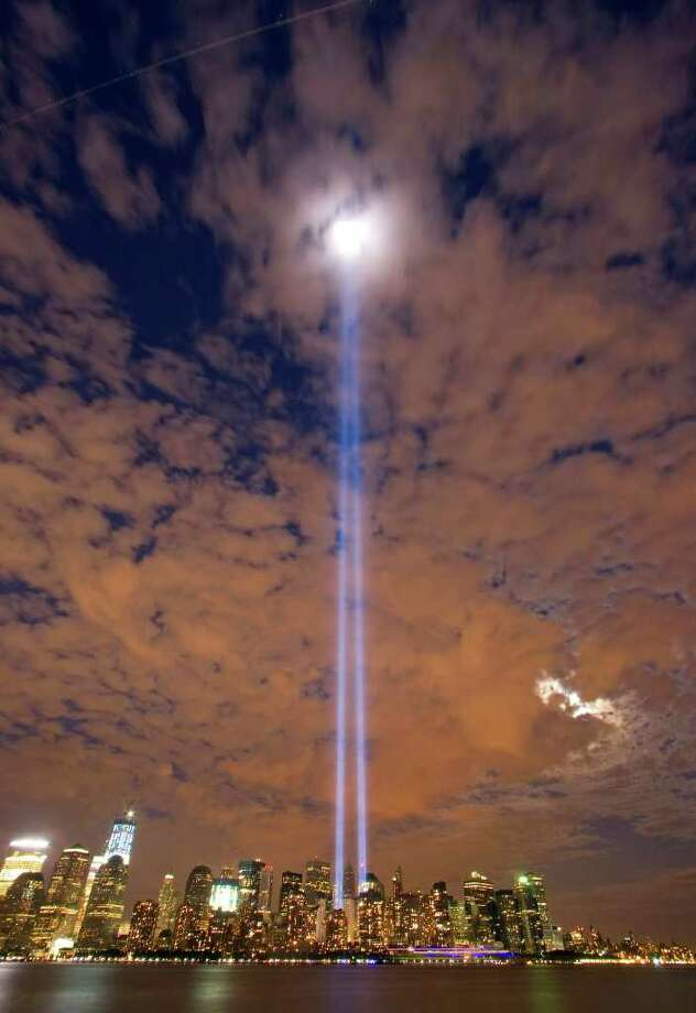 The Tribute in Light shines over lower Manhattan seen from Liberty State Park in Jersey City, N.J. shortly after sunset Saturday, Sept. 10, 2011. Sunday will mark the 10th anniversary of the September 11 attacks on the United States. Photo: AP