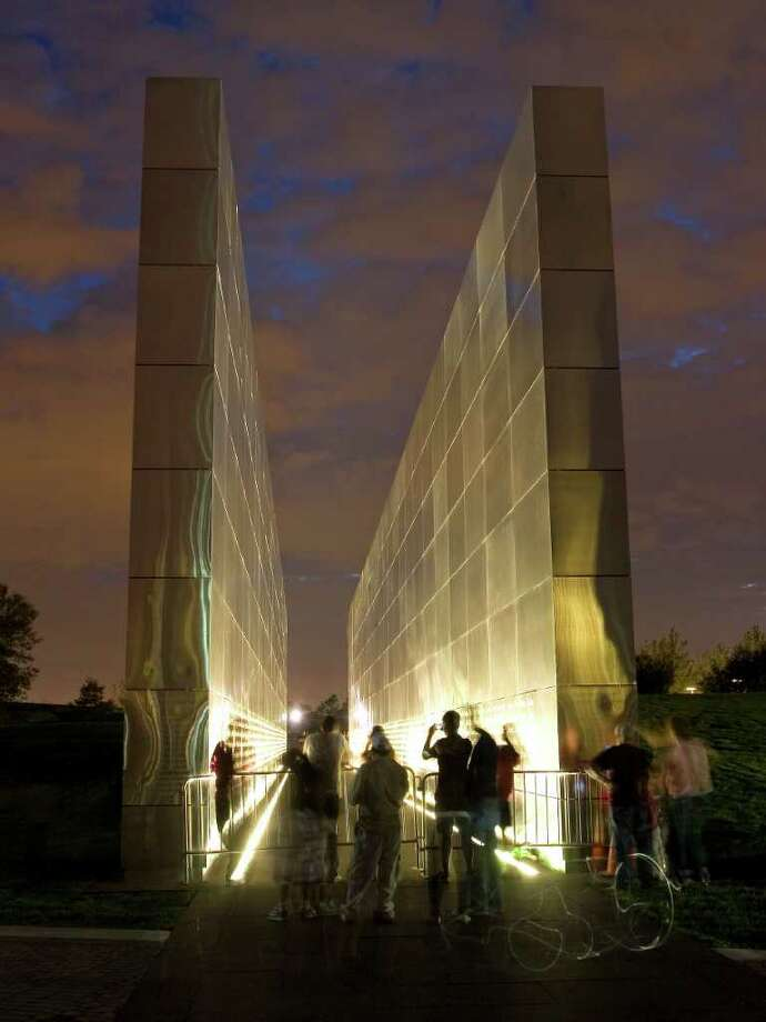 "The ""Empty Sky"" memorial is pictured shortly after sunset at Liberty State Park in Jersey City, N.J. on Saturday, Sept. 10, 2011. The memorial was dedicated Saturday honoring the 746 New Jersey residents who died on Sept. 11, 2001. Sunday will mark the 10th anniversary of the attacks on the United States. Photo: AP"