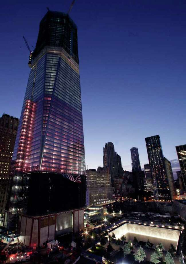 One World Trade Center towers over the site, Sunday, Sept. 11, 2011 in New York. A decade has passed since the Sept. 11 attacks when terrorists crashed hijacked planes into the World Trade Center and the Pentagon, and a fourth plane crashed into a field in rural western Pennsylvania. Photo: AP